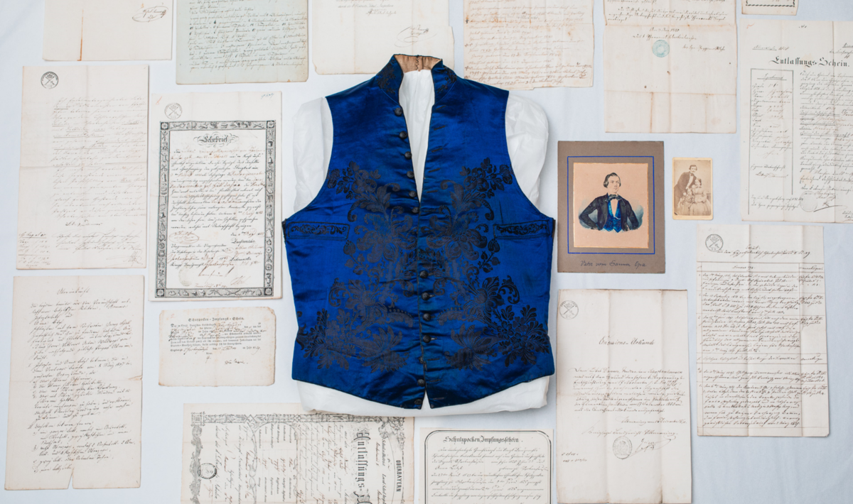 "In addition to his blue waistcoat, the Lukas Danner collection includes his birth certificate with baptismal certificate, school reports, vaccination certificates, the ""concession deed"", inventories of his estate, and Danner's apprenticeship certificate for the needle trade, dated 1843."