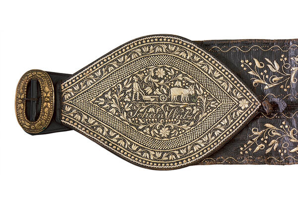 Detailed view of a brown leather belt from the Innviertel, dated about 1840, elaborately decorated with quill embroidery.